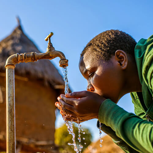 Boy Drinking From a Clean Water Well from World Vision
