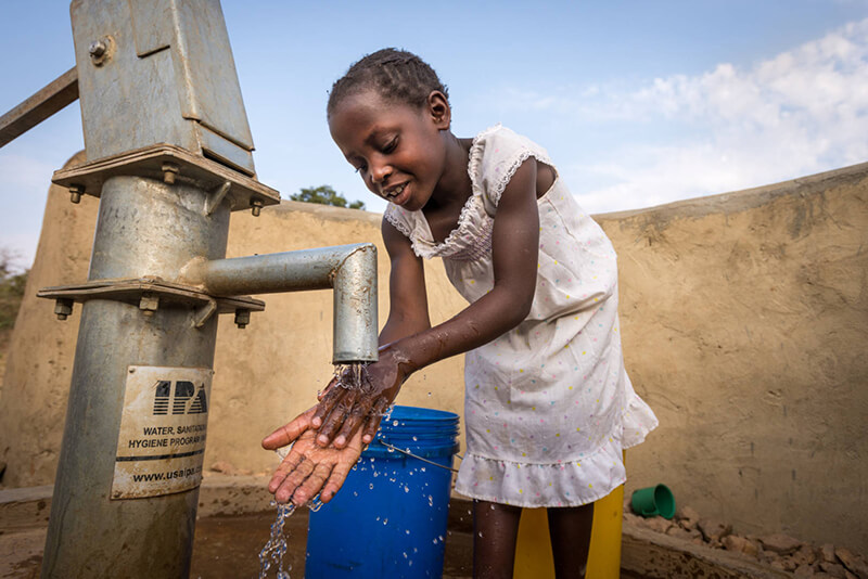 Young Girl Washing Hands from Clean Water Thanks to World Vision