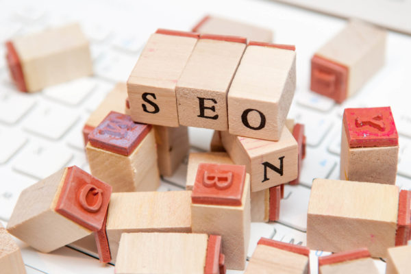 "blocks spell out""SEO"" atop a pile of illegible blocks"