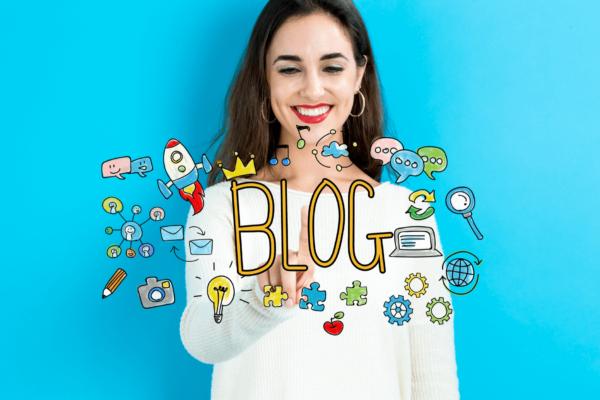 """woman standing behind word """"blog"""""""