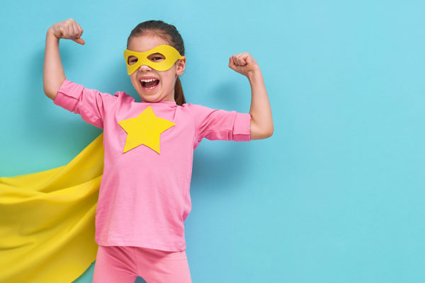 Superhero girl flexing her muscles.