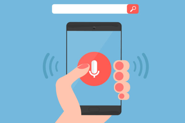 Hand using a phone for voice search