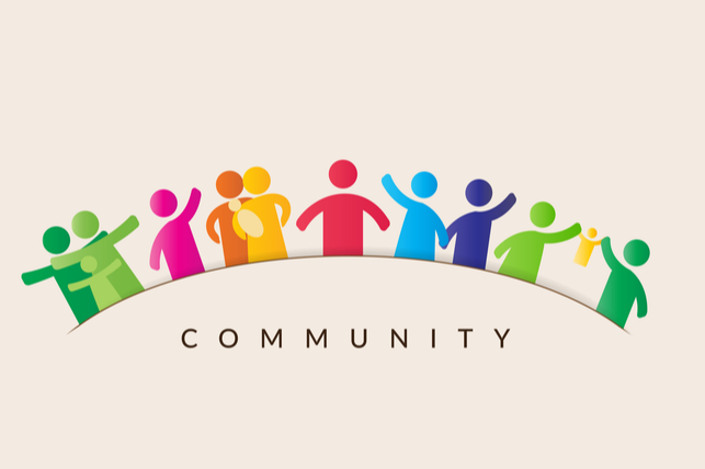 "A group of people icons interlocking arms above the word ""community."""