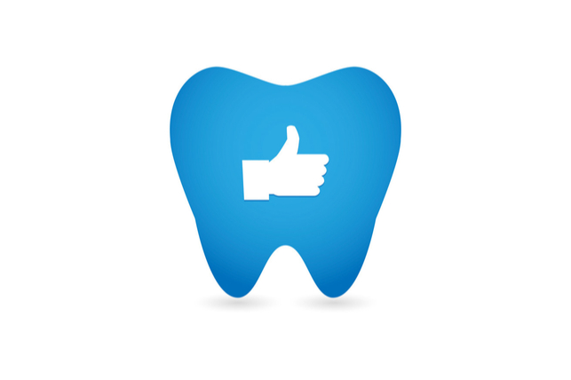 thumbs up icon set inside a cartoon tooth border