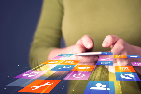 apps at woman's finger tips